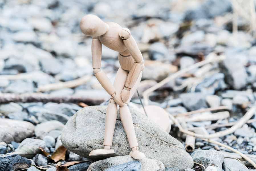 doll on a beach knee pain