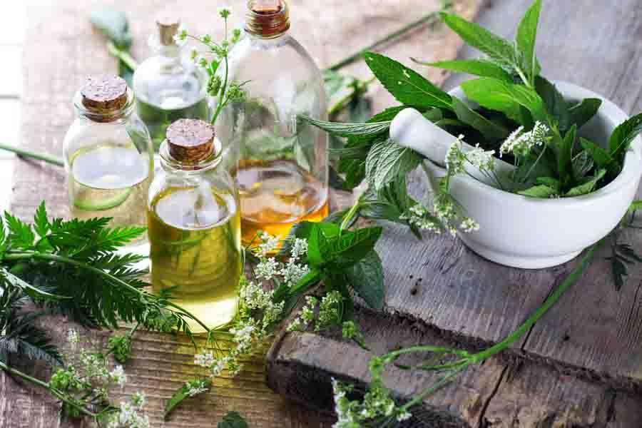 essential oil bottles on a table mortar pestil