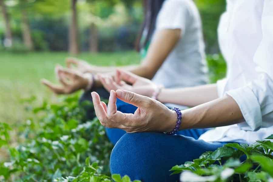 meditation outdoors older woman