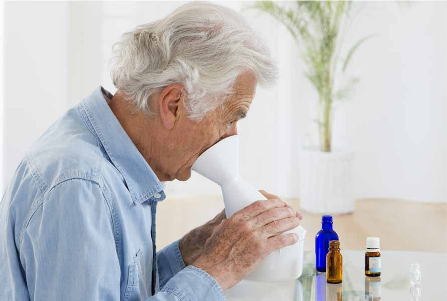 older man inhalation with essential oils